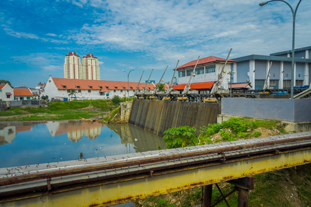 Smaller water hydropower plant located in city neighborhood, Jakarta, Indonesia