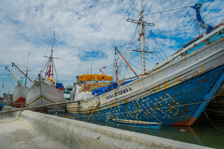 JAKARTA, INDONESIA - 5 MARCH, 2017: Inside famous old port area of Jakarta, fishing boats lying at harbor, fishermen working on a beautiful sunny day
