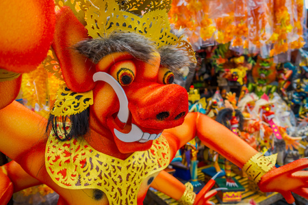 BALI, INDONESIA - MARCH 08, 2017: Impresive hand made structure od red evel face, which takes place on the even of Nyepi day in Bali, Indonesia. A Hindu holiday marked by a day of silence