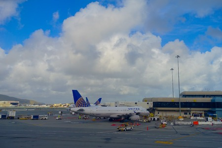 SAN FRANCISCO, CALIFORNIA - APRIL 13, 2014: United Airlines planes at the Terminal 3 in San Francisco International Airport