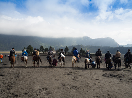 BROMO, INDONESIA - JULY 12, 2O17 : Tourists hiking up to the top of Mount Bromo, the active mount Bromo is one of the most visited tourist attractions in East Java, Indonesia Editorial