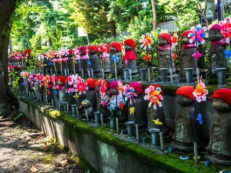 KYOTO, JAPAN - JULY 05, 2017: Jizo Boddhisattvas at Zojo Buddhist Temple at Tokyo, Japan. Jizo Bodhisattva is the patron saint of thechildrens soul according to the Japanese mythology Editorial