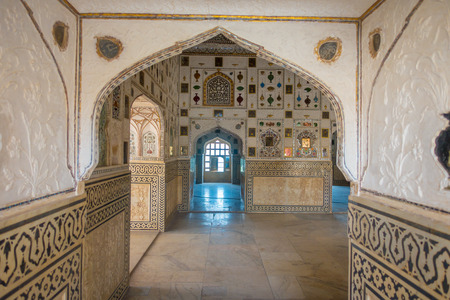 Amber, India - September 19, 2017: Beautiful Interior mughal architectural details inside of Amber Fort palace in India Editorial