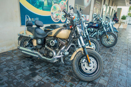 DELHI, INDIA - SEPTEMBER 19, 2017: Close up of motorcycle of Harley Davidson parked in the sreets of Delhi Royal Enfield Motorcycle, travelling in Delhi