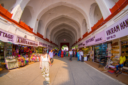 DELHI, INDIA - SEPTEMBER 25 2017: Unidentified people walking and buying inside the Bazaar in the Red Fort in Delhi, India. Meena Bazaar, built by Mukarmat Khan 300 years ago, was the first covered bazaar in India, fish eye effect Editorial