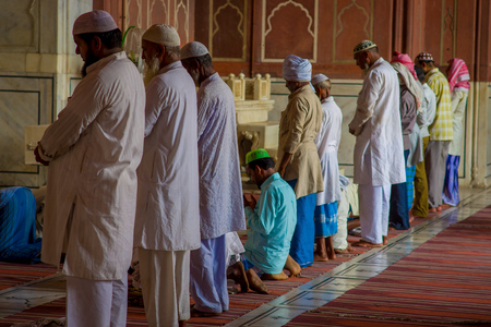 Delhi, India - September 27, 2017: Close up of goup of men standing inside of the temple preparing for pray in Jama Masjid Mosque in Delhi, India