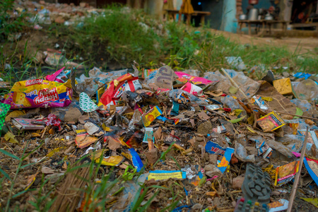 AGRA, INDIA - SEPTEMBER 19, 2017: Big garbage heap on the street on Agra, India. India is a very dirty country