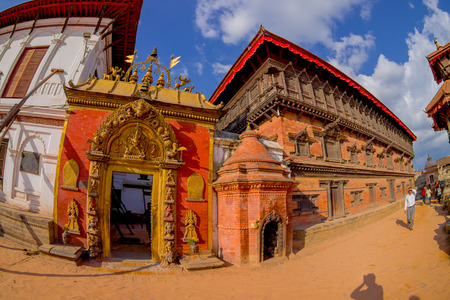 closed community: BHAKTAPUR, NEPAL - NOVEMBER 04, 2017: Beautiful golden door of a temple located in the center of Durbar Square in Bhaktapur, Kathmandu valey, Nepal