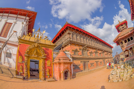closed community: BHAKTAPUR, NEPAL - NOVEMBER 04, 2017: Beautiful golden door of a temple located in the center of Durbar Square in Bhaktapur, Kathmandu valey, Nepal, fish eye effect Editorial