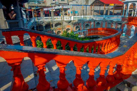 POKHARA, NEPAL OCTOBER 10, 2017: Unidentified people walking dowstairs and upstairs inside of Gupteshwor Mahadev, Nepal.