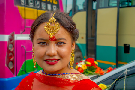 POKHARA, NEPAL OCTOBER 10, 2017: Portrait of a beautiful woman wearing typical clothes and jewelry of weeding celebration in Nepal. Editorial