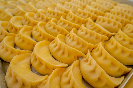 Close up of steamed Momo. A popular Nepalese food that is also common in Chiana, Bhutan, Tibet and India Stock Photo