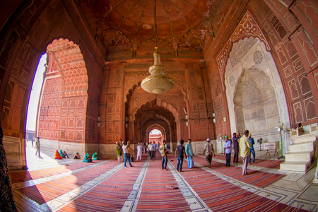 Delhi, India - September 27, 2017: Unidentified people walking inside of the temple of Jama Masjid Mosque in Delhi, India, fish eye effect