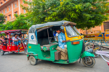 DELHI, INDIA - SEPTEMBER 19, 2017: Autorickshaw green in the streets of paharganj, there are many tourist staying in this area in Delhi in India