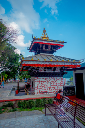 POKHARA, NEPAL - SEPTEMBER 04, 2017: Unidentified people walking around of Tal Barahi Temple, located at the center of Phewa Lake, is the most important religious monument of Pokhara.