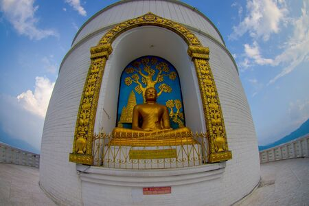POKHARA, NEPAL, SEPTEMBER 04, 2017: Golden statue of Buddha a the World Peace Pagoda, Pokhara, Nepal