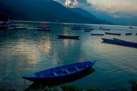 phewa: Pokhara, Nepal - September 04, 2017: Beautiful view of blue boats lakeshore in Pokhara city , Nepal Editorial