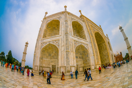 Agra, India - September 20, 2017: Unidentified people walking near of the Taj Mahal building structure, is an ivory-white marble mausoleum on the south bank of the Yamuna river in the Indian city of Agra, Uttar Pradesh, fish eye effect. Editorial