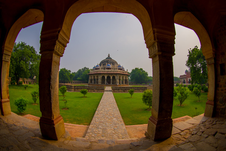 DELHI, INDIA - SEPTEMBER 19, 2017: Close up of pillars of the Isa Khan Tomb at Humayuns Tomb complex in Delhi, India. Humayuns Tomb was the first garden-tomb on the Indian subcontinent, fish eye effect