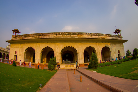 DELHI, INDIA - SEPTEMBER 25 2017: Crowd of people walking at outdoors of Inlaid marble, columns and arches, Hall of Private Audience or Diwan I Khas at the Lal Qila or Red Fort in Delhi, India, fish eye effect Editorial