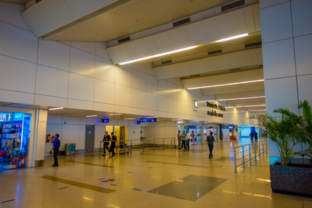 DELHI, INDIA - SEPTEMBER 19, 2017: Unidentified people walking inside of the International Airport of Delhi, Indira Gandhi International Airport is the 32th busiest in the world