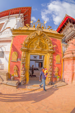 closed community: BHAKTAPUR, NEPAL - NOVEMBER 04, 2017: Beautiful golden door of a temple located in the center of Durbar Square in Bhaktapur, Kathmandu valey, Nepal, fish eye effect. Editorial