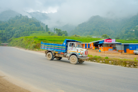 POKHARA, NEPAL OCTOBER 10, 2017: Outdoor view of truck in a pavement road, located in Pokhara, Nepal.