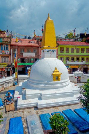 KATHMANDU, NEPAL OCTOBER 15, 2017: Unidentified people working at outdoors over the full restoration after 2015 earthquake damage in the monument of Boudhanath stupa . Kathmandu, Nepal Editorial