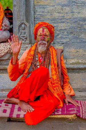 KATHMANDU, NEPAL - MARCH 22, 2017: Close up of Yogi in Pashupatinath Temple of Kathmandu, Nepal Editorial