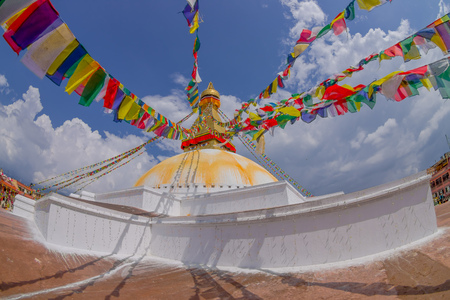 KATHMANDU, NEPAL OCTOBER 15, 2017: heritage monument Boudhanath stupa and its colorful flags in daylight with bue sky, following full restoration after 2015 earthquake damage. Kathmandu, Nepal, fish eye effect. Editorial