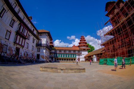 KATHMANDU, NEPAL OCTOBER 15, 2017: Unidentified people walking in the afternoon of Durbar square in Kathmandu, capital of Nepal in a beautiful blue sky in sunny day, fish eye effect.