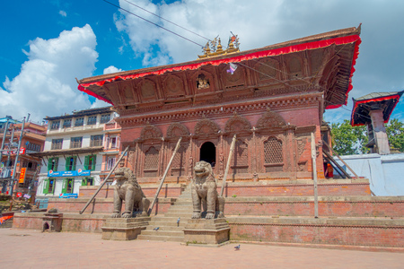 KATHMANDU, NEPAL OCTOBER 15, 2017: Two huge stoned lions at the enter of a temple of Durbar Square near the old Indian temples in Katmandu, Nepal. Editorial