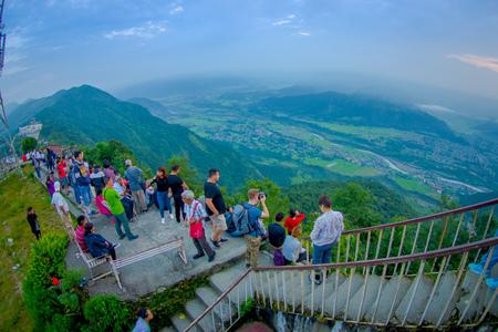 POKHARA, NEPAL, SEPTEMBER 04, 2017: Unidentified tourist walking upstairs at hilltop of the Sarangkot lookout point in the mountain to view Annapurna Range during sunrise at Sarangkot, Nepal, fish eye effect