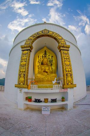 POKHARA, NEPAL, SEPTEMBER 04, 2017: Golden statue of Buddha a the World Peace Pagoda, Pokhara, Nepal