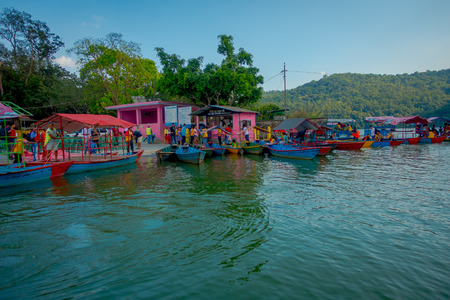 phewa: POKHARA, NEPAL - SEPTEMBER 04, 2017: Outdoor view of many boats parked in a row in the Phewa tal-lake in Pokhara, Nepal