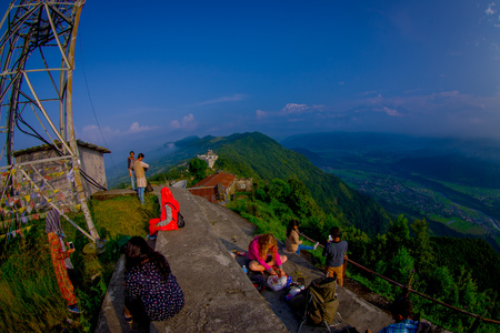 POKHARA, NEPAL, SEPTEMBER 04, 2017: Unidentified tourist at hilltop of the Sarangkot lookout point in the mountain to view Annapurna Range during sunrise at Sarangkot, Nepal