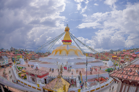 KATHMANDU, NEPAL OCTOBER 15, 2017: A front view of Boudhanath Stupa building at outdoors, with some buildings in the horizont in Kathmandu, Nepal.
