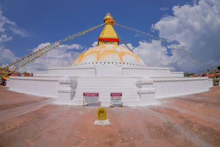 KATHMANDU, NEPAL OCTOBER 15, 2017: heritage monument Boudhanath stupa and its colorful flags in daylight with bue sky, following full restoration after 2015 earthquake damage. Kathmandu, Nepal, fish eye effect. Editorial