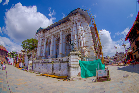 KATHMANDU, NEPAL OCTOBER 15, 2017: Huge buildings with some structures for reconstruction after the earthquake in 2015 of Durbar square in Kathmandu, capital of Nepal, in a beautiful blue sky, fish eye effect.