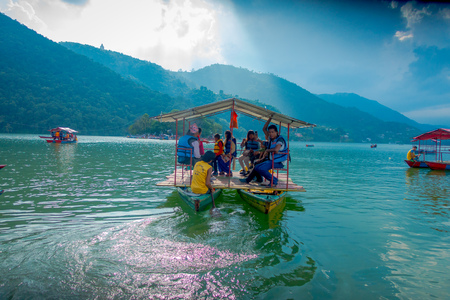 POKHARA, NEPAL - SEPTEMBER 04, 2017: Unidentified people enjoying a trip in ab oat in the Phewa tal-lake in Pokhara, Nepal Editorial