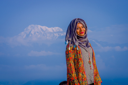 Pockhara, Nepal, September, 06 -2017: Close up of beautiful nepalese woman wearing a hijab in a nature background