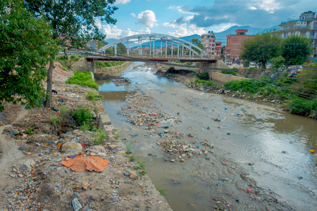 Outdoor view of garbage in a small river in the suburbs of Kathmandu, Nepal