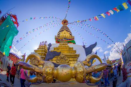KATHMANDU, NEPAL OCTOBER 15, 2017: Big golden Vajra weapon in front of the Swayambhunath stupa in Kathmandu, Nepal