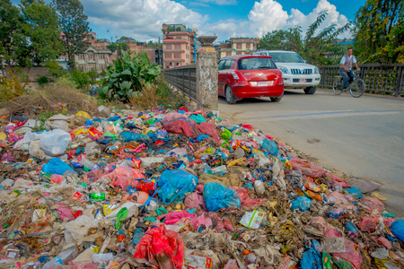 KATHMANDU, NEPAL OCTOBER 15, 2017: Food and pile of domestic garbage in landfill. Only 35 of population have access to adequate sanitation.