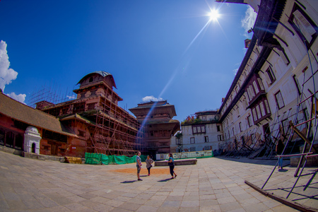KATHMANDU, NEPAL OCTOBER 15, 2017: Unidentified people walking in the afternoon of Durbar square in Kathmandu, capital of Nepal in a beautiful blue sky in sunny day, fish eye effect