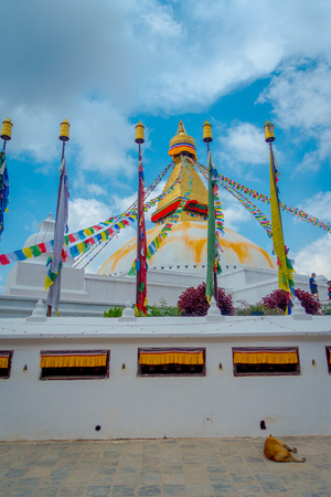 KATHMANDU, NEPAL OCTOBER 15, 2017: Unesco heritage monument Boudhanath stupa and its colorful flags in daylight with bue sky, following full restoration after 2015 earthquake damage. Kathmandu, Nepal, fish eye effect Editorial