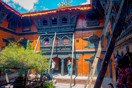KATHMANDU, NEPAL OCTOBER 10, 2017: Unidentified people walking in front of the Kumari Ghar, built in 1757 in Kathmandu, Nepal. Photos are permitted in the courtyard but strictly prohibited to photograph Kumari
