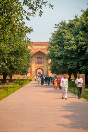 DELHI, INDIA - SEPTEMBER 19, 2017: Unidentified people walking in front of a Mogul King Humayuns Tomb in a stoned ground during a sunny day in New Delhi, India. Editorial
