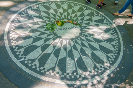 NEW YORK, USA - NOVEMBER 22, 2016: Strawberry Fields mosaic in the floor of Central park in New York City, USA.
