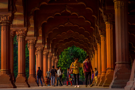 Jaipur, India - September 19, 2017: Unidentified people walking inside of Muslim architecture detail of Diwan-i-Am, or Hall of Audience, inside the Red Fort in Delhi, India Editorial
